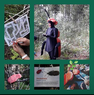 Kovakuoriaispukuun pukuun pukeutunut opas metsässä lasten kanssa.